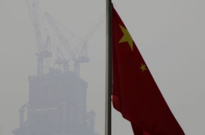 A Chinese flag is seen near a construction site in Beijing's central business area, China, 17 January 2017. (Photo: REUTERS/Jason Lee)