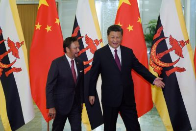 Chinese President Xi Jinping shows the way to the meeting room to Brunei's Sultan Hassanal Bolkiah before the bilateral meeting of the Second Belt and Road Forum at the Great Hall of the People on 26 April 2019 in Beijing, China. (Photo: Andrea Verdelli/Pool via Reuters).