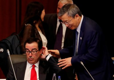 China's Central Bank Governor Yi Gang approaches to greet US Treasury Secretary Steven Mnuchin during the G20 finance ministers and central bank governors meeting in Fukuoka, Japan, 8 June 2019 (Photo: Reuters/Kim Kyung-Hoon).