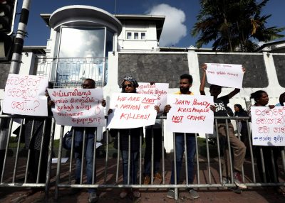A group of Sri Lankans hold placards during a protest condemning signed death sentences for four people convicted of drug-related offences in a decision by Sri Lanka's President Maithripala Sirisena, in front of the Welikada Prison in Colombo, Sri Lanka 28 June 2019. (Photo: Reuters/ Dinuka Liyanawatte).