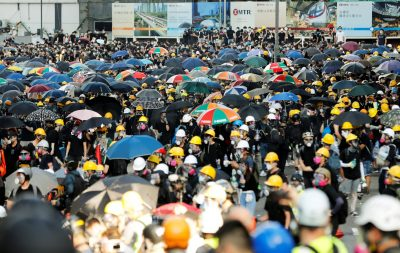 Protesters carry umbrellas as they attend a demonstration in support of the city-wide strike and to call for democratic reforms in Hong Kong, China, 5 August 2019 (Photo: Reuters/Kim Kyung-Hoon).
