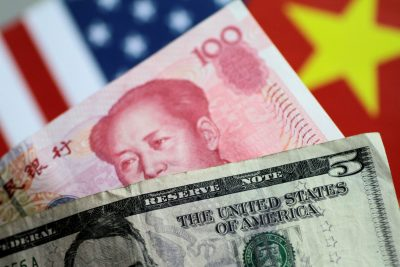 US dollar and Chinese yuan notes are seen in this picture, 2 June 2017 (Photo: Reuters/Thomas White).