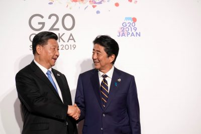 China's President Xi Jinping is greeted by Japan's Prime Minister Shinzo Abe at the G20 leaders summit in Osaka, Japan, 28 June 2019 (Photo: Reuters/Kevin Lamarque).