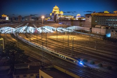 A CRH (China Railway High-speed) bullet train leaves the Beijing West railway station at night in Beijing, China, 8 July 2019 (Photo: Reuters/Liu Jiaye).