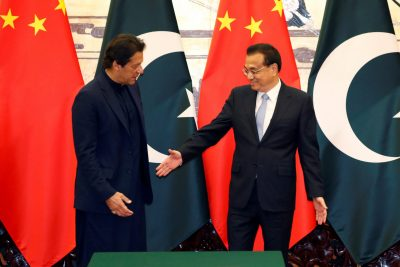 Pakistan's Prime Minister Imran Khan and Chinese Premier Li Keqiang shake hands during a signing ceremony at the Great Hall of the People in Beijing, China, 8 October 2019 (Photo: Reuters/Yukie Nishizawa).