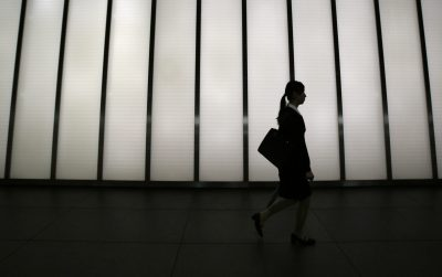 A job seeker walks past a corridor of a commercial building in Tokyo, Japan, 28 August 2014 (Photo: Reuters/Yuya Shino).
