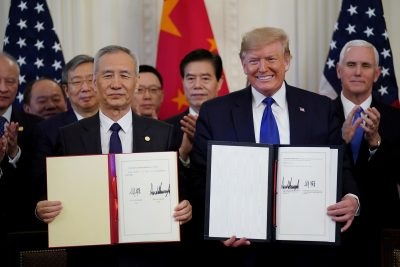 US President Donald Trump stands Chinese Vice Premier Liu He after signing 'phase one' of the US-China trade agreement in the East Room of the White House in Washington, US, 15 January 2020 (Photo: Reuters/Kevin Lamarque).