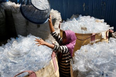 A worker sorts used plastic bottles to be recycled at a plastic recycling centre in Denpasar, Bali, Indonesia, 21 June, 2019 (Photo: Reuters/Christo).