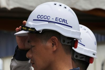 A worker adjusts his safety helmet at the tunnel constructions site of the East Coast Rail Link (ECRL) project in Dungun, Terengganu, Malaysia, 25 July 2019 (Photo:Reuters/Lim Huey Teng).