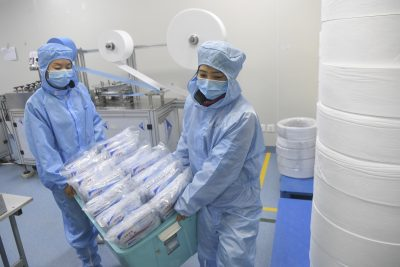 Workers make masks at a medical supplies company on 11 February 2020 (Photo: Reuters).