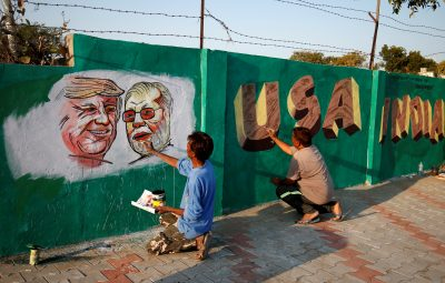 Painting US President Donald Trump and Indian Prime Minister Narendra Modi on a wall along the route that Trump and Modi will take during Trump's upcoming visit, Ahmedabad, India, 17 February 2020 (Photo: Reuters/Amit Dave).
