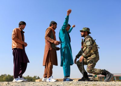 An Afghan National Army soldier inspects passengers at a checkpoint in Khogyani district of Nangarhar province, Afghanistan, 23 February (Photo: Reuters/Parwiz).