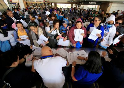 Around 190 Overseas Filipino Workers (OFW) from Kuwait submit their documents upon their arrival at the Ninoy Aquino International Airport, following President Rodrigo Duterte's call to evacuate workers after a Filipina was found dead in a freezer, Pasay city, Metro Manila, Philippines, 23 February 2018 (Photo: Reuters/Romeo Ranoco).