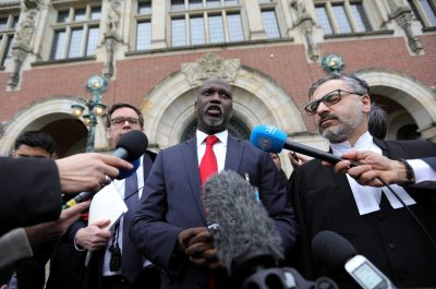 Gambia's Justice Minister Abubacarr Tambadou talks to the media outside the International Court of Justice (ICJ), after the ruling in a case filed by Gambia against Myanmar alleging genocide against the minority Muslim Rohingya population, in The Hague, Netherlands 23 January, 2020 (Photo: Reuters/Plevier).