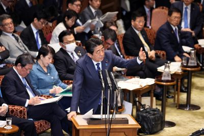 Japanese Prime Minister Shinzo Abe answers a question by an opposition lawmaker at Upper House's budget committee session at the National Diet in Tokyo on Monday, 2 March , 2020 (Photo: Reuters/Tsunoda).
