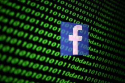 The Facebook logo and binary cyber codes are seen in this illustration taken, 26 November 2019 (Photo: Reuters/Dado Ruvic).