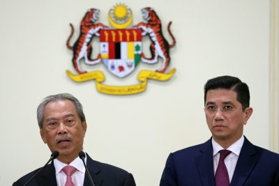 Malaysia's Prime Minister Muhyiddin Yassin speaks next to Minister of International Trade and Industry Azmin Aliduring a news conference in Putrajaya, Malaysia, 11 March 2020 (Photo: Reuters/Lim Huey Teng).