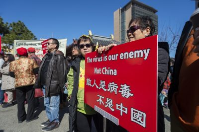 People participate in a rally in support of Chinese American and Chinese people and people around the world in fighting the novel coronavirus, COVID-19, in Chinatown, San Francisco, California, United States, 29 February 2020 (Photo: Yichuan Cao/Sipa USA).