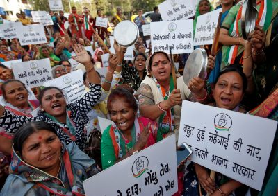 Supporters of India's main opposition Congress party shout slogans during a protest against inflation in Ahmedabad, India, 2 March 2020 (Photo: Reuters/Amit Dave).