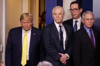 US President Donald Trump walks towards White House trade adviser Peter Navarro, Treasury Secretary Stephen Mnuchin and Anthony Fauci, director of the NIH National Institute of Allergy and Infectious Diseases, as he arrives for the daily Coronavirus-related briefing at the White House in Washington DC, 9 March 2020 (Photo: REUTERS/Jonathan Ernst).