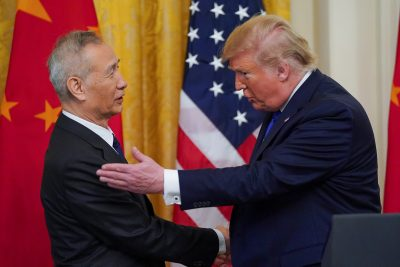 "U.S. President Donald Trump applauds greets Chinese Vice Premier Liu He prior to signing ""phase one"" of the U.S.-China trade agreement with Liu in the East Room of the White House in Washington, U.S., 15 January 2020 (Reuters/Kevin Lamarque)."