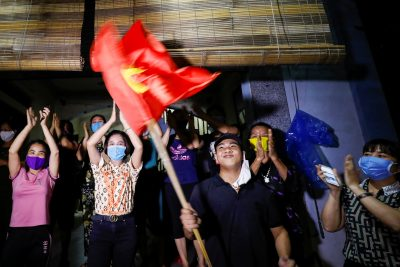 Residents celebrate after authorities lifted the quarantine in Dong Cuu village, the last Vietnamese quarantined village affected by COVID-19, outside Hanoi, Vietnam, 14 May 2020 (Photo: Reuters/Kham).