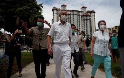 Singapore's Prime Minister Lee Hsien Loong and his wife Ho Ching arrive at a polling station during Singapore's general election amid the COVID-19 pandemic, Singapore, 10 July 2020 (Photo: Reuters/Edgar Su).