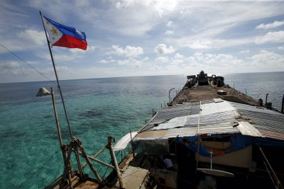 A Philippine flag flutters from BRP Sierra Madre, a dilapidated Philippine Navy ship that has been aground since 1999 and became a Philippine military detachment on the disputed Second Thomas Shoal, part of the Spratly Islands, in the South China Sea, 29 March 2014 (Reuters/ Erik De Castro/File Photo).