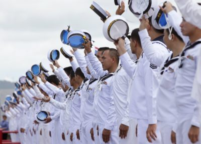 Royal Thai Navy seamen wave to their colleagues as they depart to the Gulf of Aden in Somalia from the Royal Thai Navy base, in Sattahip, Chonburi province, east of Bangkok, 10 September, 2010 (Reuters/Chaiwat Subprasom).