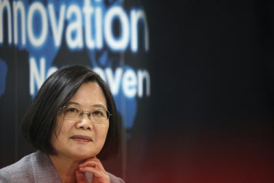 Taiwanese president Tsai Ing-Wen listens to a presentation at a non woven filter fabric factory, where the fabric is used to make surgical face masks, in Taoyuan, Taiwan, 30 March, 2020 (Reuters/Ann Wang).