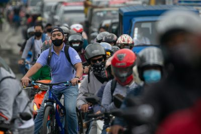 A cyclist looks on as traffic builds up at a checkpoint on the first day of the government's reimplementation of a stricter lockdown to curb coronavirus disease (COVID-19) infections, in Marikina City, Metro Manila, Philippines, 4 August, 2020 (Photo: Reuters/Eloisa Lopez)