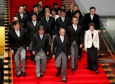 Japan's Prime Minister Yoshihide Suga (C) leads his cabinet ministers as they prepare for a photo session at Suga's official residence in Tokyo, Japan, 16 September 2020. (Photo: Reuters/Issei Kato).
