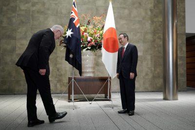 Australian Prime Minister Scott Morrison greets Japan's Prime Minister Yoshihide Suga prior to the official welcome ceremony at Suga's official residence in Tokyo, Japan, 17 November 2020 (Photo: Eugene Hoshiko/Pool via Reuters).