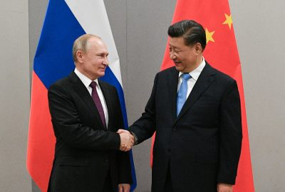 Russian President Vladimir Putin shakes hands with Chinese President Xi Jinping during their meeting on the sideline of the 11th edition of the BRICS Summit in Brasilia, Brazil, 13 November 2019 (Photo: Reuters/Sputnik/Ramil Sitdikov/Kremlin).