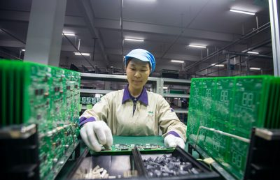 A worker inspects and arranges production for elevator signal system at a factory of Jiangsu WELM Technology Co., Ltd. in Hai'an city, east China's Jiangsu province, 24 August, 2020 (Photo: Reuters).
