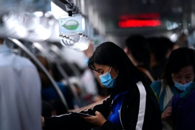 A passenger wearing a face mask following the coronavirus disease (COVID-19) outbreak uses her phone on a subway train in Beijing, China 29 September, 2020 (Photo: Reuters/Tingshu Wang).