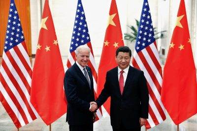 Chinese President Xi Jinping shakes hands with US Vice President Joe Biden inside the Great Hall of the People in Beijing, 4 December 2013 (Photo: Reuters/Lintao Zhang).