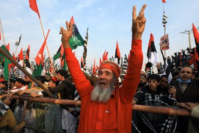 A supporter of the Pakistan Democratic Movement (PDM), an alliance of political opposition parties, chants slogans with others during an anti-government protest rally in Peshawar, Pakistan 22 November, 2020 (Photo: Reuters/Aziz).