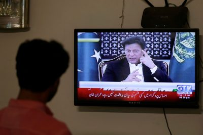 A television screen displays Prime Minister of Pakistan Imran Khan, announcing the extension of a country-wide lockdown for two weeks, due to the ongoing spread of the coronavirus disease (COVID-19), in Karachi, Pakistan, 14 April 2020 (Photo: Reuters/Akhtar Soomro).