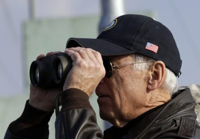 Joe Biden looks through binoculars to see North Korea from Observation Post Ouellette during a tour of the Demilitarized Zone (DMZ), the military border separating the two Koreas, in Panmunjom, 7 December 2013 (Photo: Reuters/Lee Jin-man/Pool).