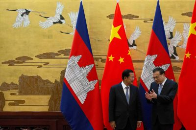 Cambodian Prime Minister Hun Sen chats with Chinese Premier Li Keqiang during a signing ceremony at the Great Hall of the People in Beijing, China, 22 January, 2019 (Photo: Ng Han Guan/Pool via Reuters).