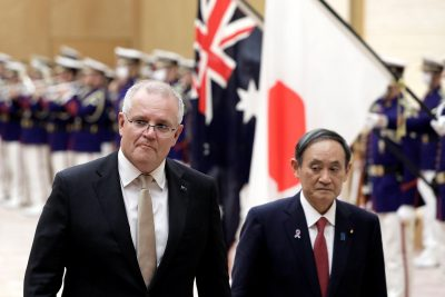 Australia's Prime Minister Scott Morrison and Japan's Prime Minister Yoshihide Suga review an honor guard during a ceremony ahead of a meeting at Suga's official residence in Tokyo, Japan, 17 November, 2020 (Photo: Kiyoshi Ota/Pool via Reuters).