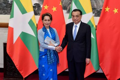 Myanmar's State Counsellor Aung San Suu Kyi shakes hands with Chinese Premier Li Keqiang as they pose for media before their meeting on 25 April 2019 at the Diaoyutai State Guesthouse in Beijing, China (Photo: Reuters/Parker Song).