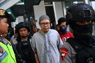 A chief of Jemaah Ansharut Daulah (JAD), the country's largest Islamic State-linked group, arrives for his trial at South Jakarta court in Jakarta, Indonesia, 31 July, 2018 (Photo: Antara Foto/Sigid Kurniawan via Reuters).