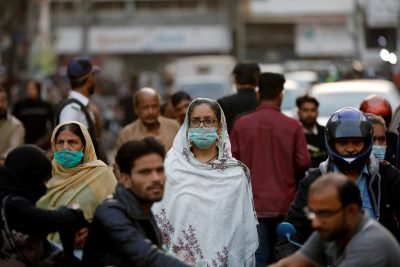 Women wear protective masks as they walk through a crowd along a market, as the outbreak of the coronavirus disease (COVID-19) continues, in Karachi, Pakistan 2 December, 2020 (Photo: Reuters/Akhtar Soomro/File Photo).