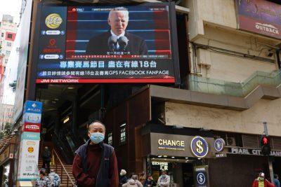A TV screen shows news of US President Joe Biden after his inauguration, in Hong Kong, China, 21 January 2021 (Photo: Reuters/Tyrone Siu).