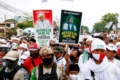 People gather for the homecoming of Rizieq Shihab, the leader of Indonesian Islamic Defenders Front (FPI) who has resided in Saudi Arabia since 2017 in Jakarta, Indonesia, 10 November, 2020 (Photo: Reuters/Ajeng Dinar Ulfiana).
