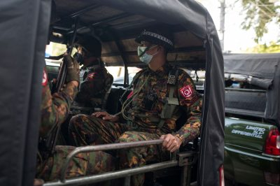 Myanmar soldiers sit inside a vehicle as they guard in front of a Hindu temple in the downtown area in Yangon, Myanmar, 2 February 2021 (Photo: Reuters/Stringer).