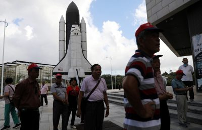 People stand in front of a scaled model of the Challenger space shuttle at a space science museum in Wenchang, Hainan province, China, 22 November 2020 (Photo: Reuters/Tingshu Wang).  - 159790849 870781973703959 7907404524768887842 n 400x259 - China's commercial space sector shoots for the stars