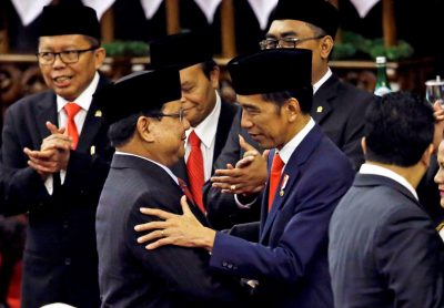 Indonesian President Joko Widodo is congratulated by Prabowo Subianto, who was his former rival in April's election, after his presidential inauguration for the second term at the House of Representatives building in Jakarta, Indonesia, 20 October 2019 (Photo: Reuters/Achmad Ibrahim/Pool).